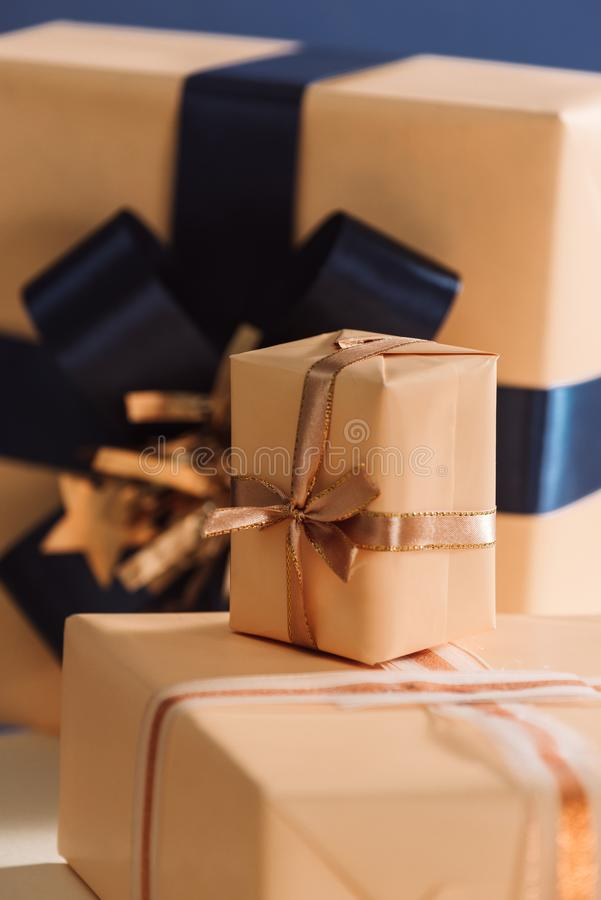 Gold and blue boxes on table closed up. Chrismas gifts stock photo