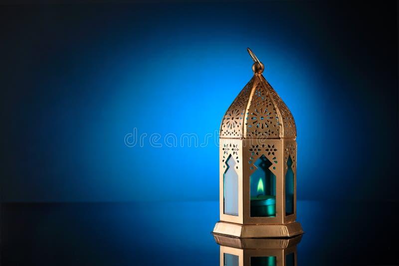 Gold and Blue Islamic Lantern for Ramadan / Eid Celebrations. On blue background stock photography
