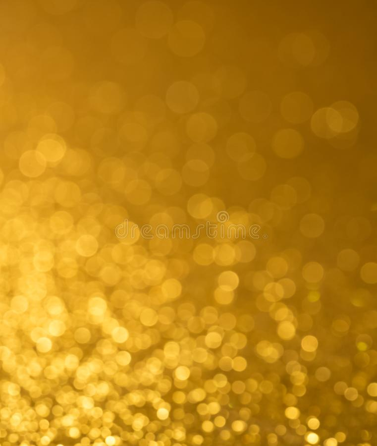 Gold bokeh background abstract blur celebrity luxury texture. Gold yellow bokeh background glitter shine abstract texture stock photo