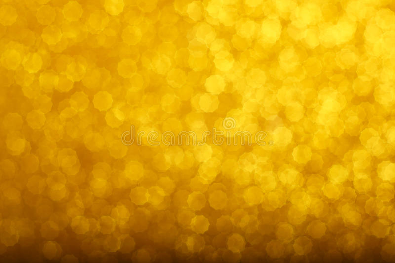 Gold bokeh background. Abstract gold bokeh background of glowing lights, party, holiday, christmas royalty free stock photos