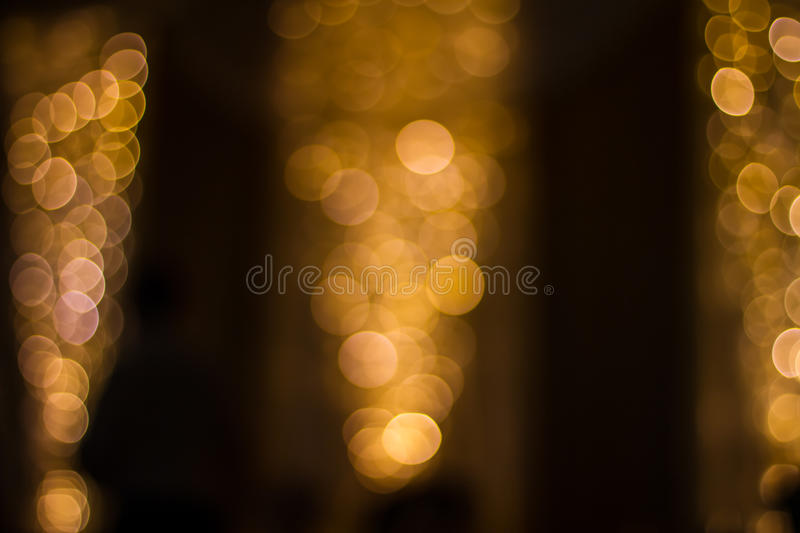 Gold bokeh background. Yellow gold bubble background gold Christmas lights blurred background decor elegant celebration design stock images