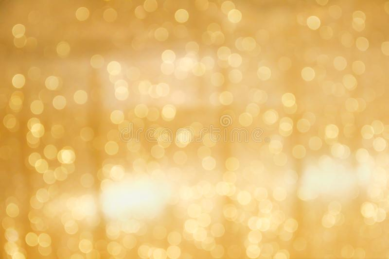Gold bokeh sparkle glitter abstract patterns for Christmas and Happy new year background royalty free stock photo