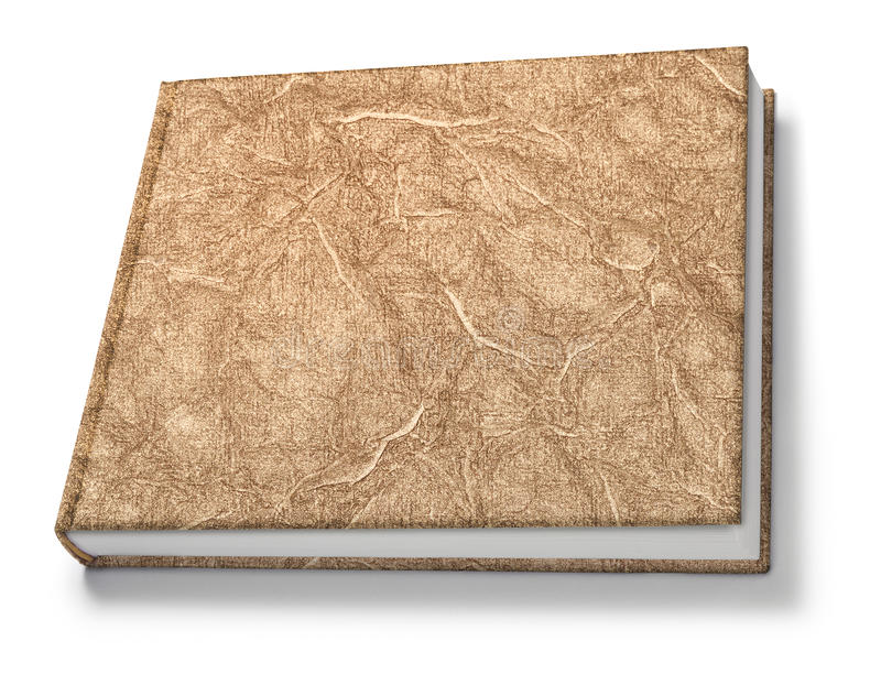 Gold Book Isolated. A book with a gold textured cover isolated on white royalty free stock photo