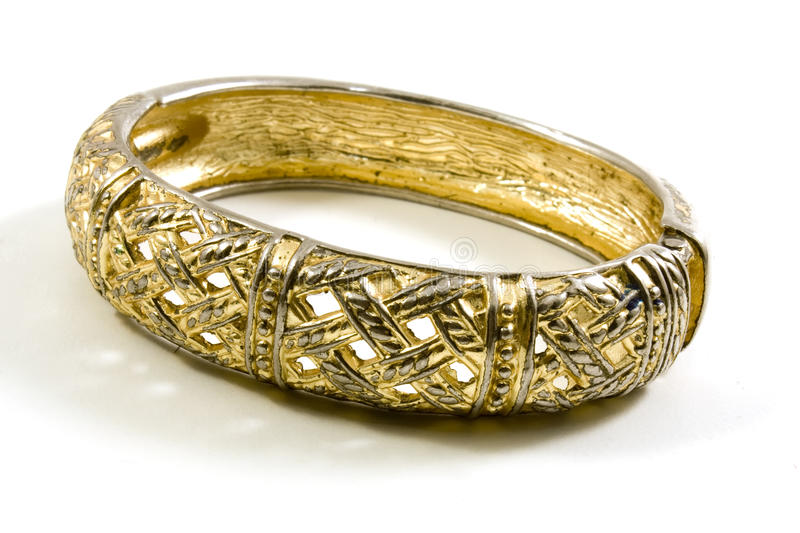 Gold bracelet. With bright reflections stock photography