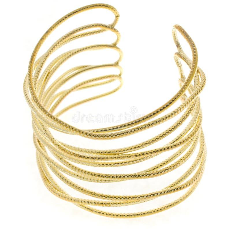 Gold bracelet. Delicate gold bracelet on the white background stock image