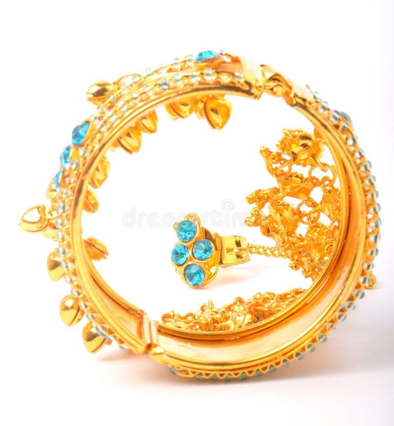 Gold bracelet. 22 karat gold bracelet standing on isolated background royalty free stock photo