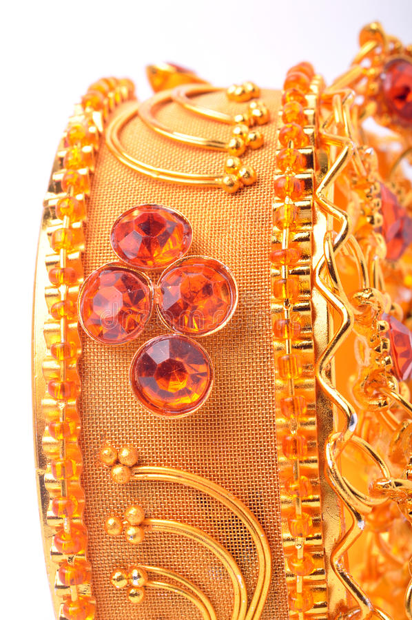 Gold bracelet. 22 karat gold bracelet standing on isolated background stock image