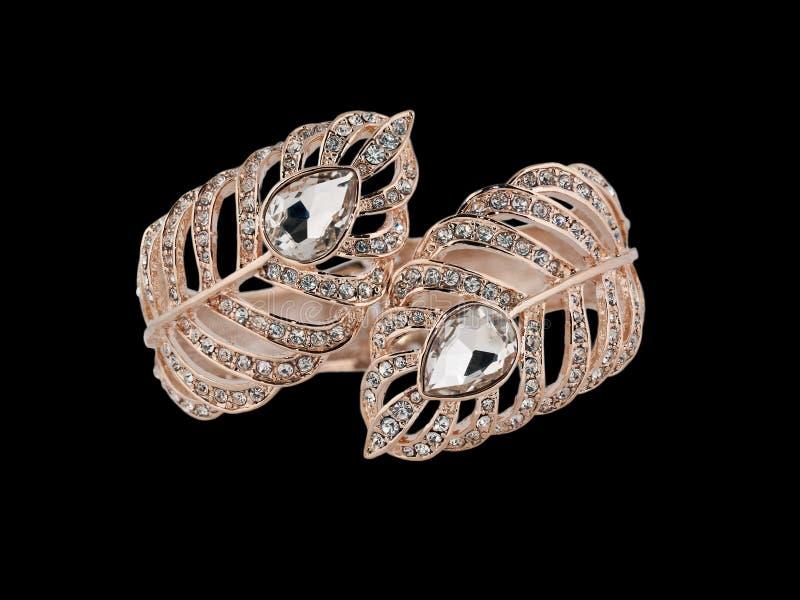 Gold bracelet. Luxury lady's gold and diamond bracelet on black background stock photos