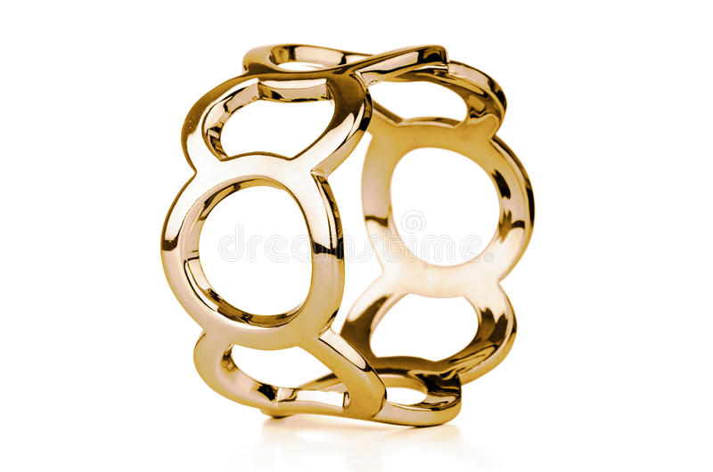 Gold bracelet. Isolated on white a background royalty free stock photo