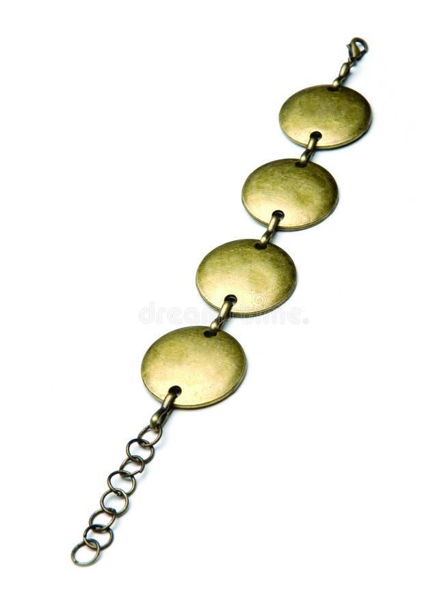 Gold bracelet. On white background stock image