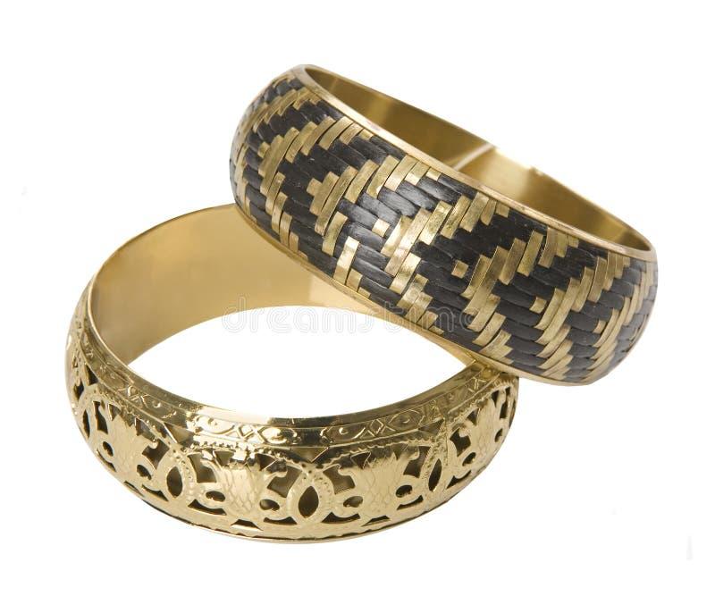 Gold bracelet. Fashion isolated woman gold bracelet stock images