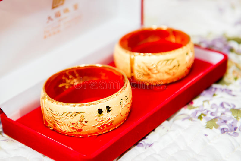 Gold bracelet for Chinese wedding. A pair of gold bracelet for Chinese wedding royalty free stock photography