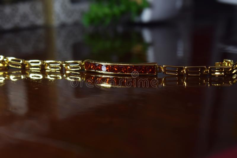 Gold bracelet designs for Ladies Tasteful Set with red ruby, stock photos
