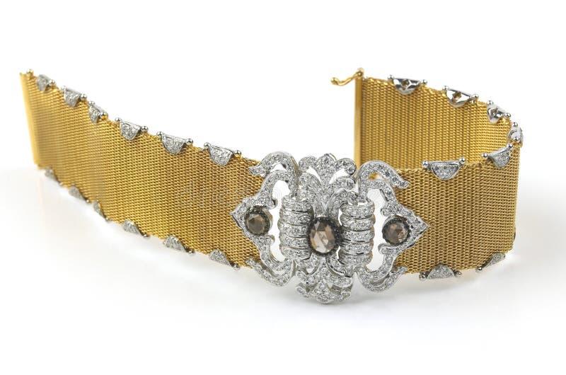 Gold bracelet with diamonds. On white background royalty free stock photos