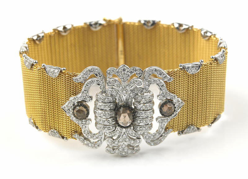 Gold bracelet with diamonds. In white background royalty free stock image