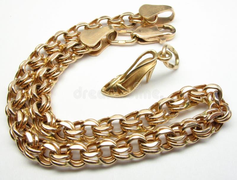 Gold Bracelet And High Heel Shoe Stock Photos