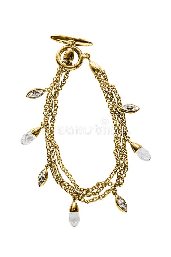 Gold bracelet isolated. Elegant gold chain bracelet with crystals isolated over white stock photos