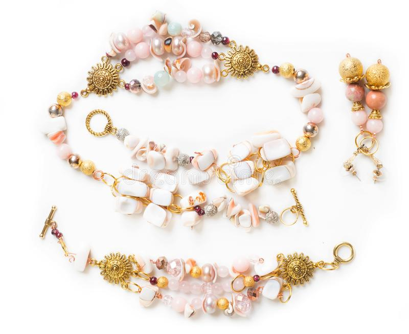 Gold bracelet and necklace with pearls and pink quartz and earr royalty free stock photography
