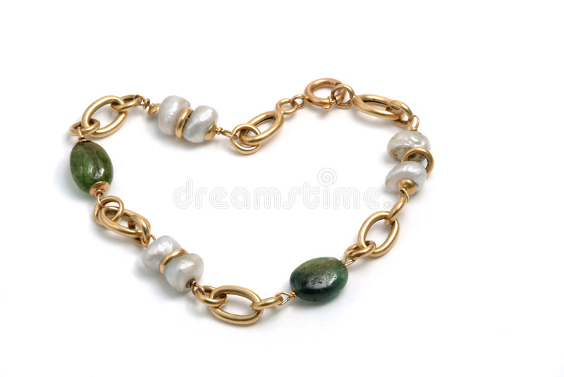 Gold bracelet with pearls. Beautiful gold bracelet with pearls royalty free stock photos