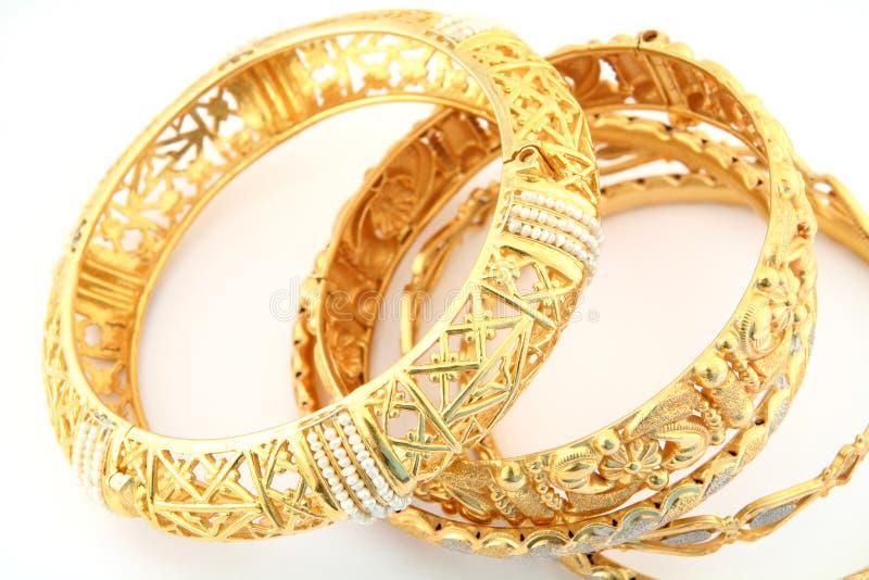 Gold bracelets 3 stock photography