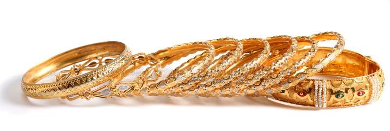 Gold bracelets royalty free stock image