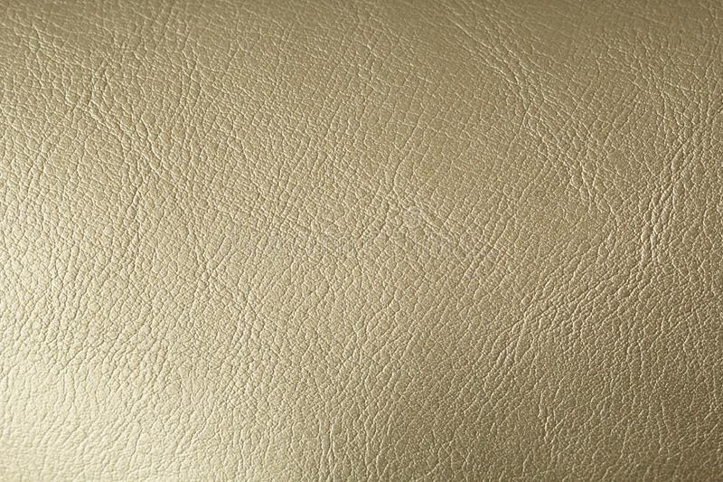 Gold or Bronze Natural Leather Background. Shiny yellow leaf gold foil texture background. Place for Text royalty free stock image