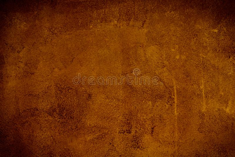 Gold brown background paper with vintage grunge background texture with black scuffed edges and old faded antique design has copy stock photos