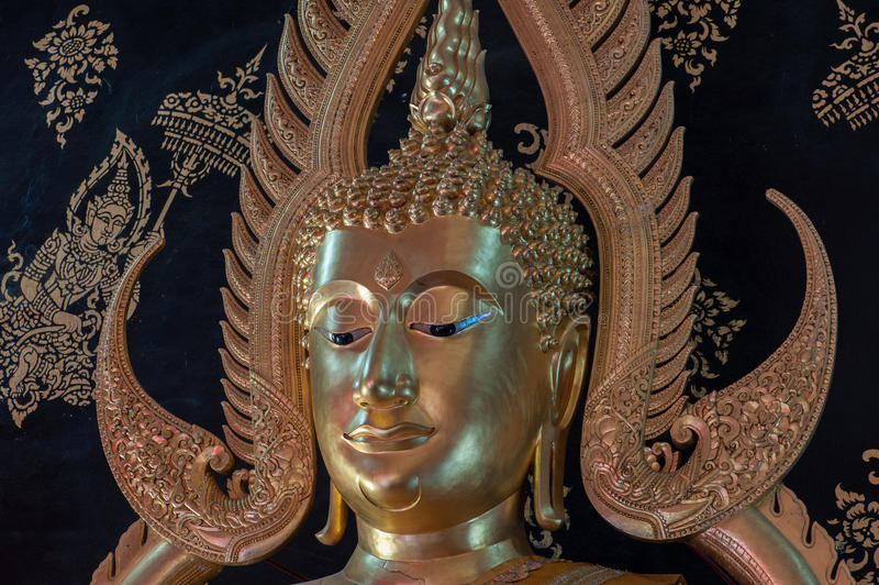 A Gold Buddha Statue in Phrae, Thailand. Against a black background royalty free stock images
