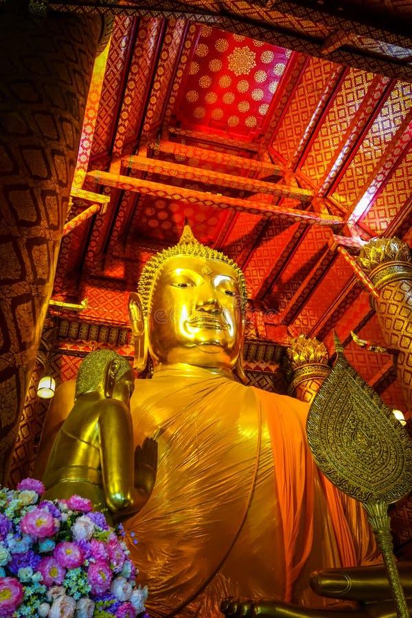 Gold Buddha statue, Wat Phanan Choeng, Ayutthaya, Thailand. Gold Buddha statue, Wat Phanan Choeng temple, Ayutthaya, Thailand royalty free stock image