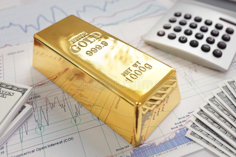 Gold bullion bar on a stocks and shares chart royalty free stock image