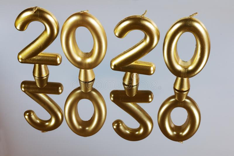 Gold candle background for 2020 year royalty free stock images