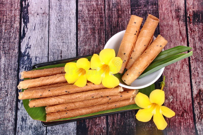 Gold candy rolls ,Thai sweetmeat made of flour, coconut milk and royalty free stock photos