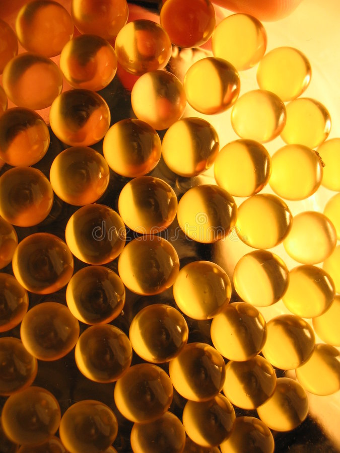 Gold capsules royalty free stock images