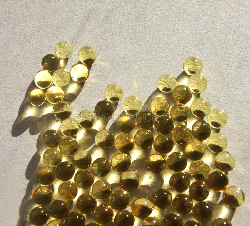 Gold capsules stock photos