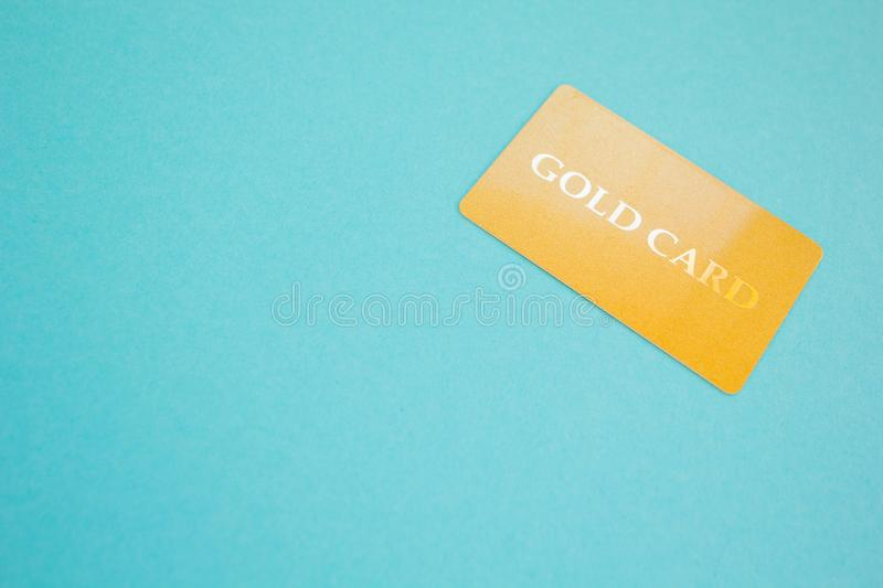 Gold card on a blue background, concept. Space for text stock photos