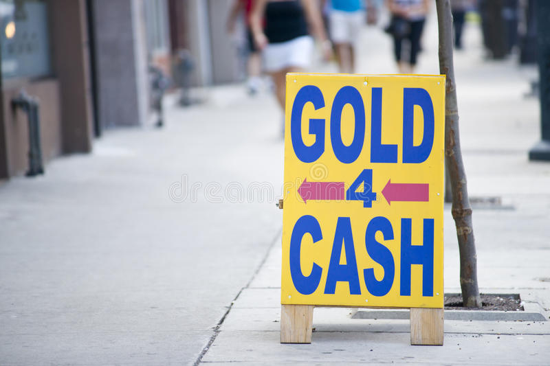 Gold for cash sign stock photos