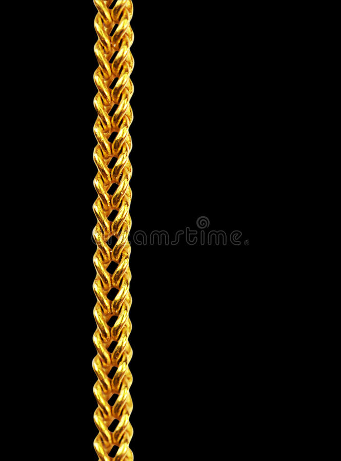 Gold chain necklace isolated on black, closeup , clipping path stock image