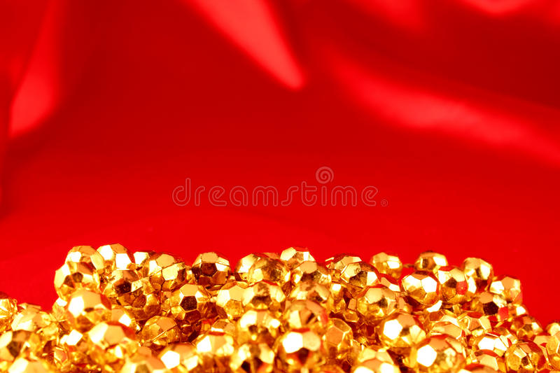 Gold chain on a red background stock image