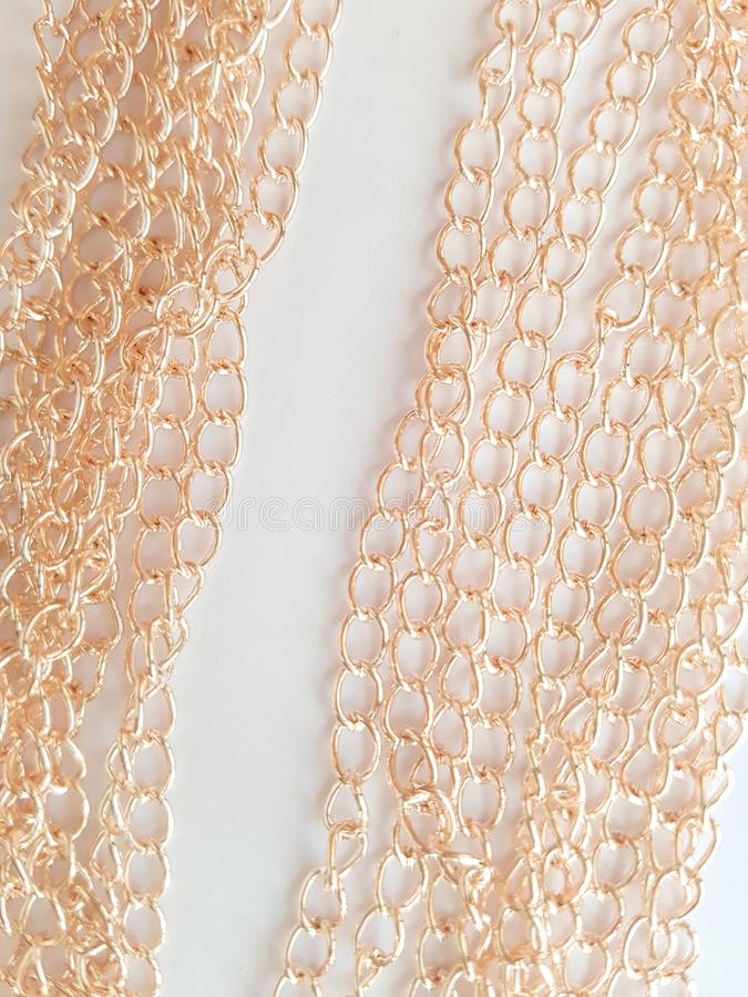 Gold chains on a white background stock images
