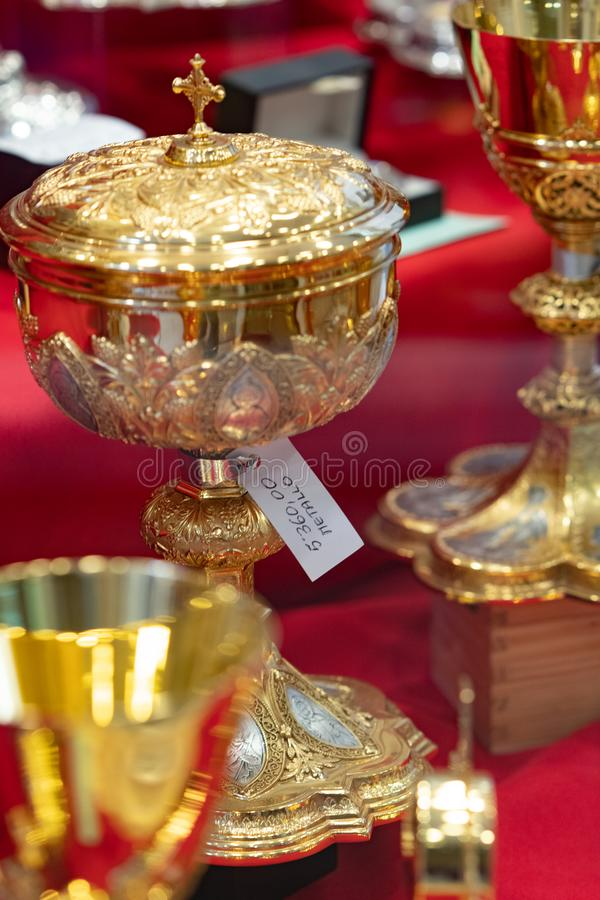 Gold chalices or goblets stock image