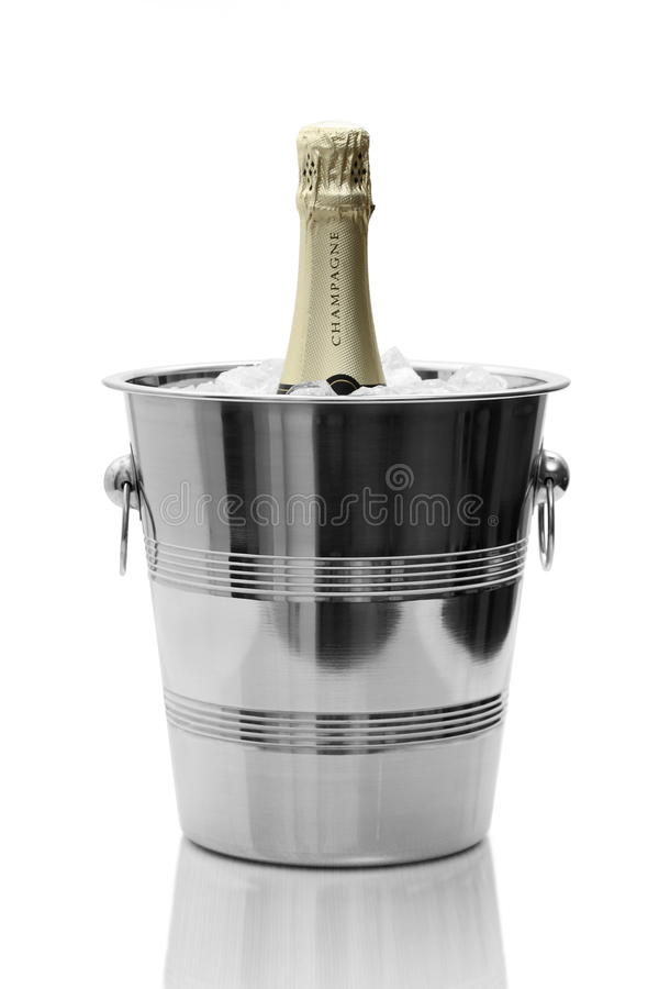 Gold Champagne bottle in cooler royalty free stock photos
