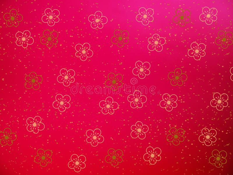 Gold cherry blossom flower shape on red background for Chinese new year card stock image