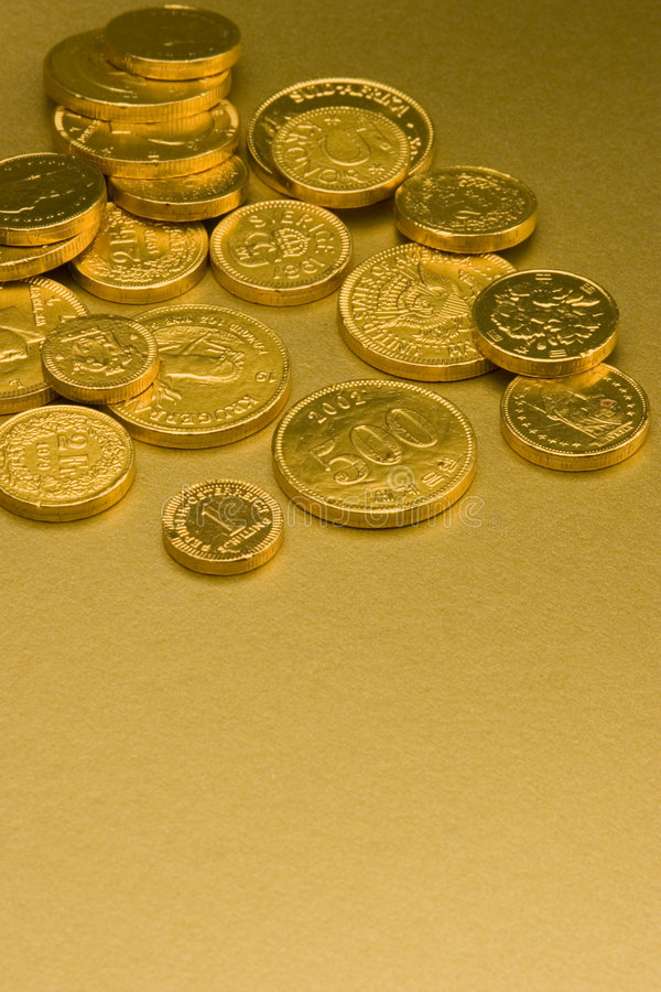 Gold Chocolate Coins. Set against a gold background royalty free stock photography