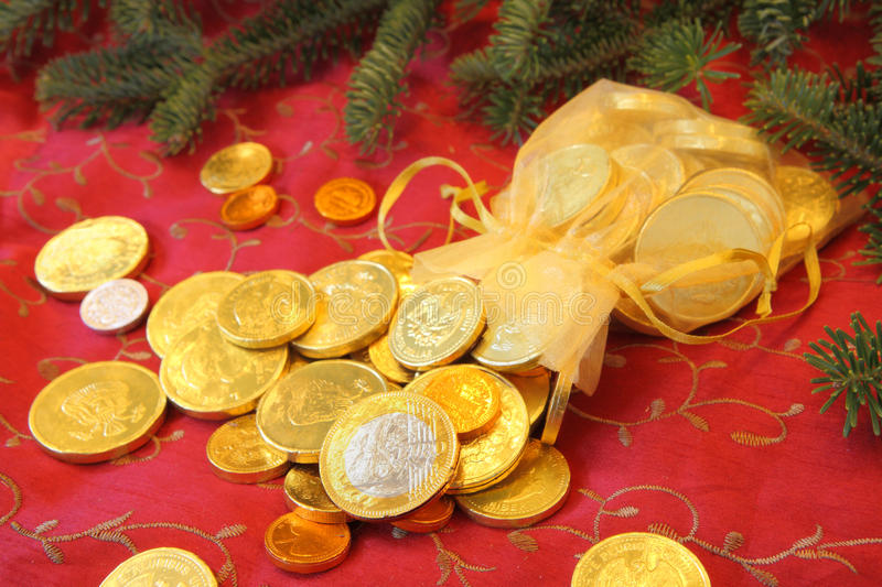 Gold Chocolate Coins for a Christmas gift royalty free stock photo