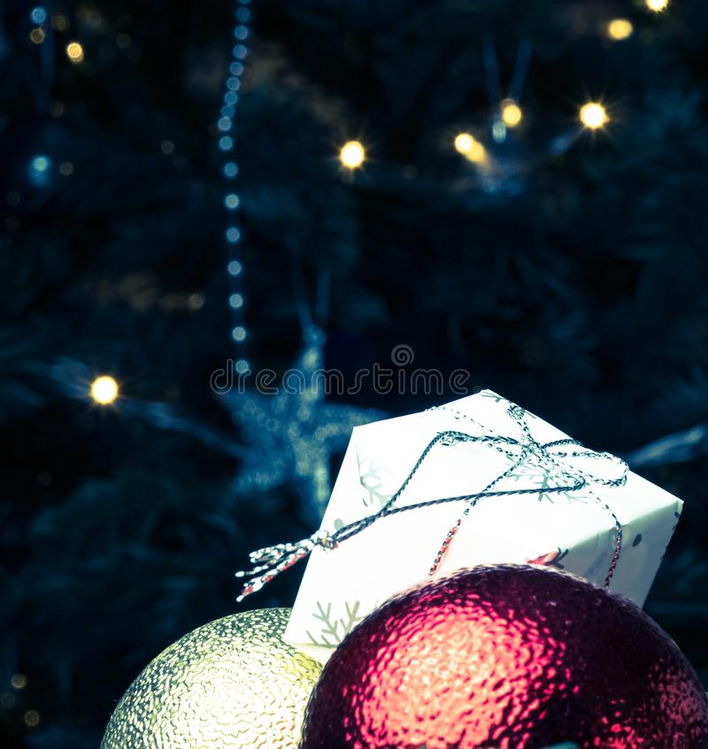 Gold Christmas background of de-focused lights with decorated tree royalty free stock photos