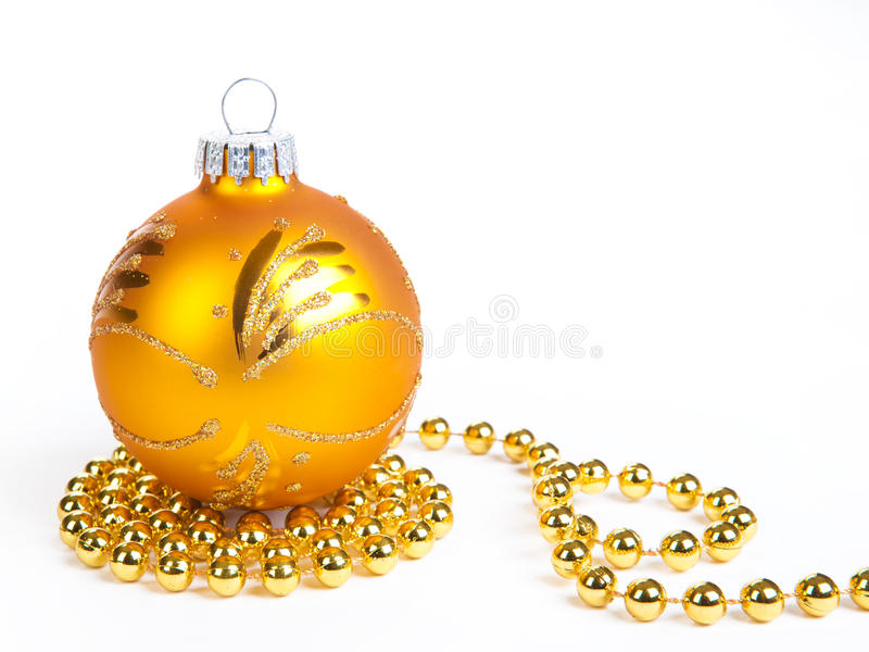 Gold christmas ball and gold decoration, isola. Ted on white stock photography