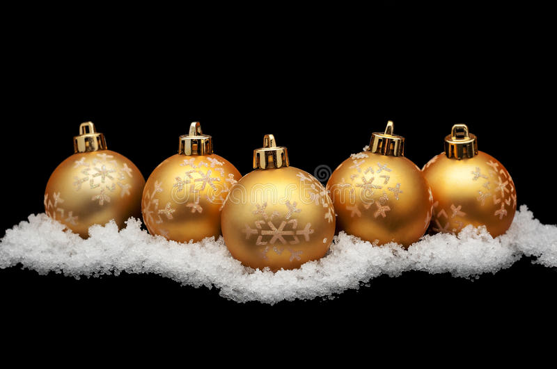 Gold christmas balls with snow