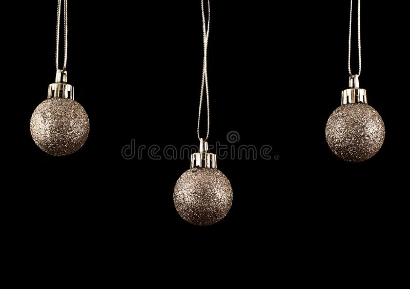 Gold Christmas Bauble or balls, decorations. Black background royalty free stock photos