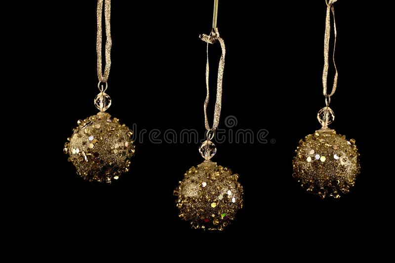 Gold Christmas Bauble or balls, decorations. Black background stock photos