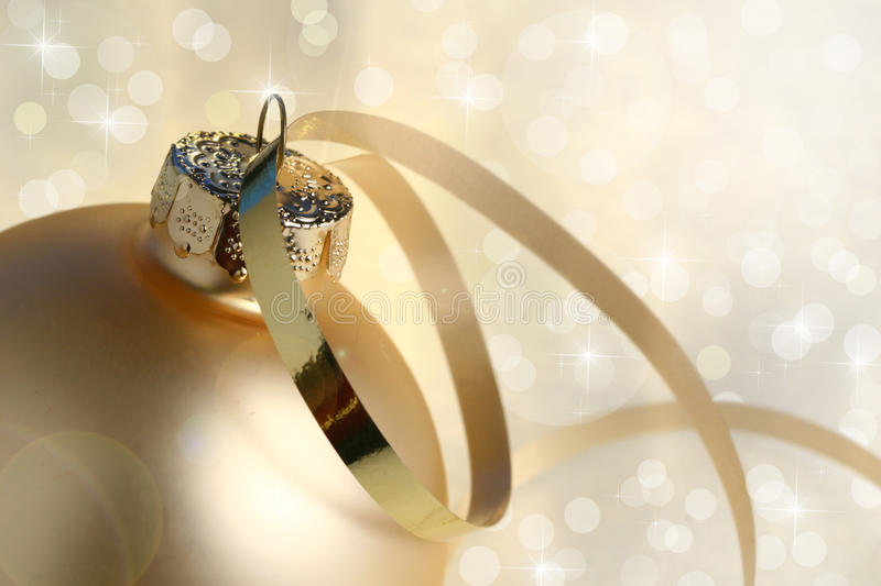 Gold Christmas Bauble and lights royalty free stock photography